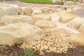 Gravel Mulch and Rock Edging leanding to the concrete tunnel.